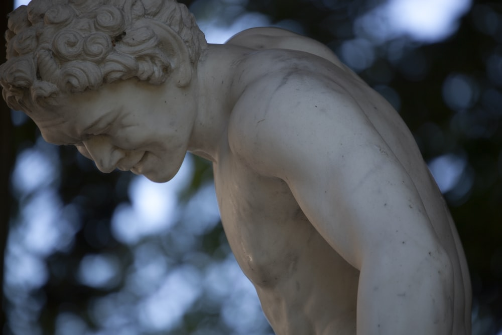 white angel statue during daytime