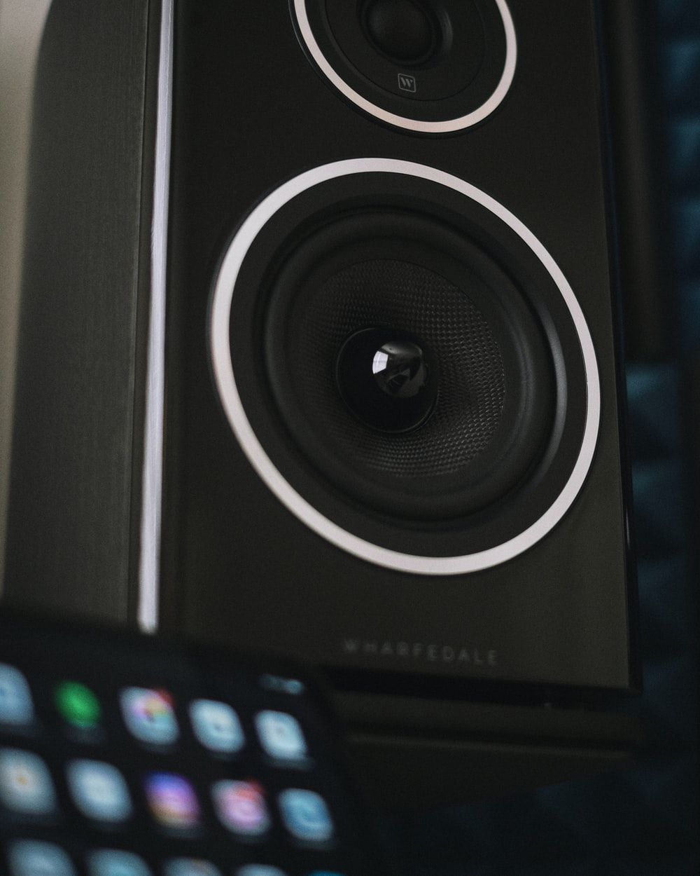 black and gray speaker with blue light
