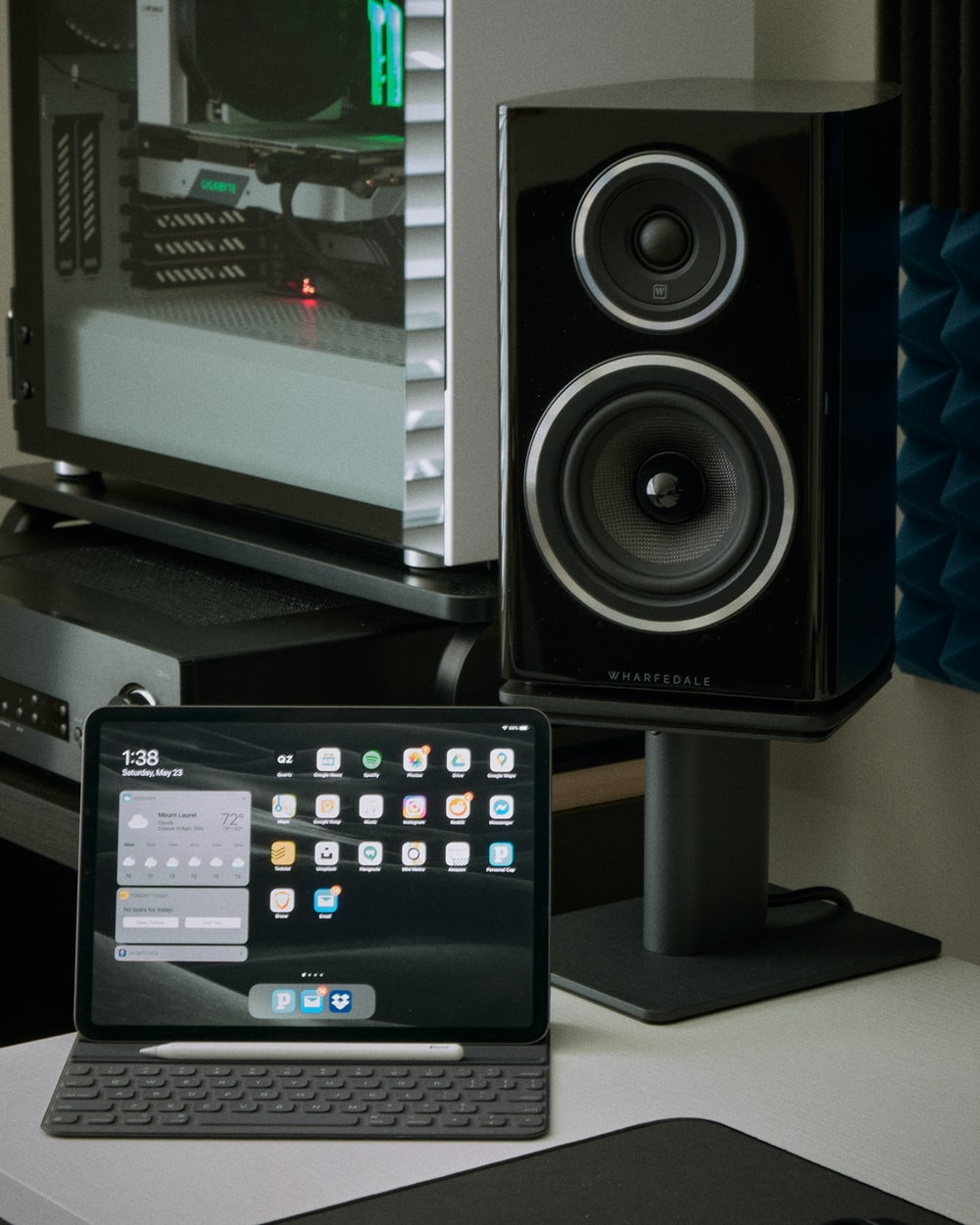 black and gray speaker beside black flat screen computer monitor