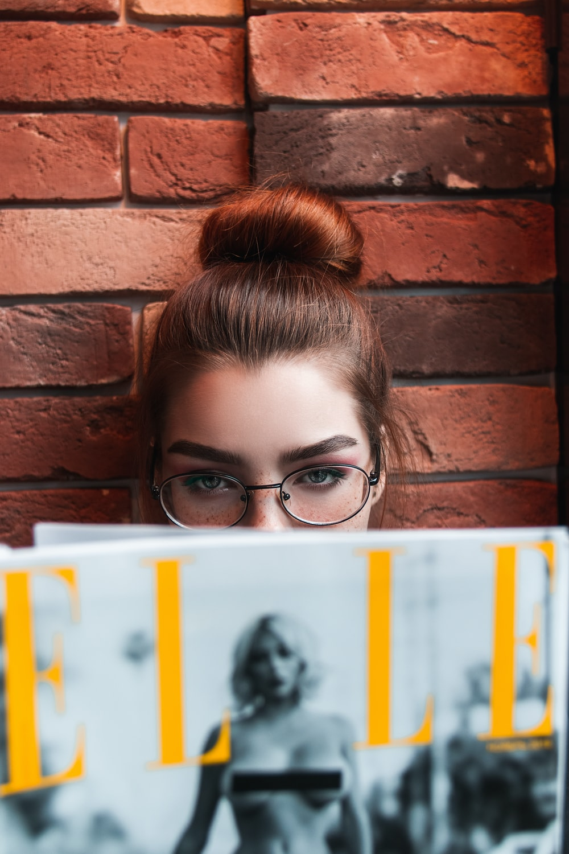 girl wearing black framed eyeglasses