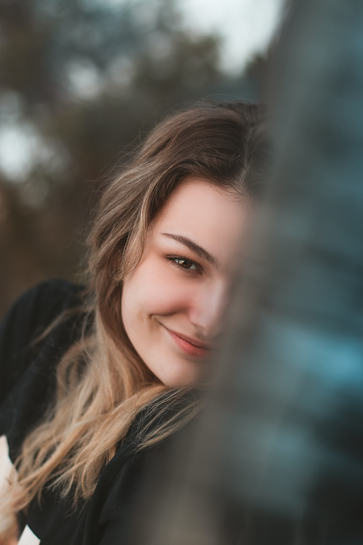 woman in black long sleeve shirt smiling