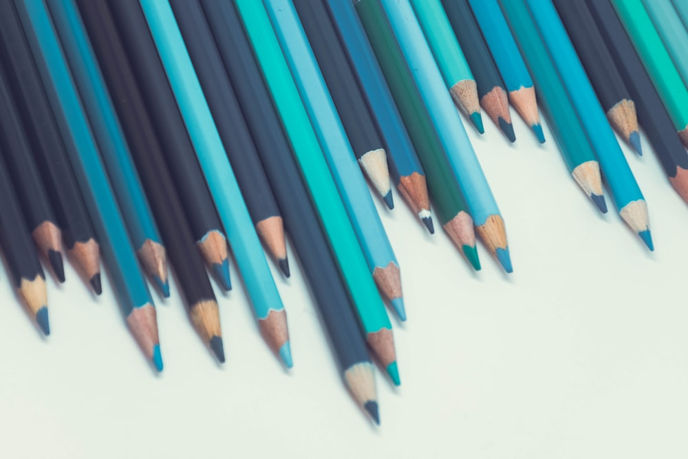 blue coloring pencils on white surface