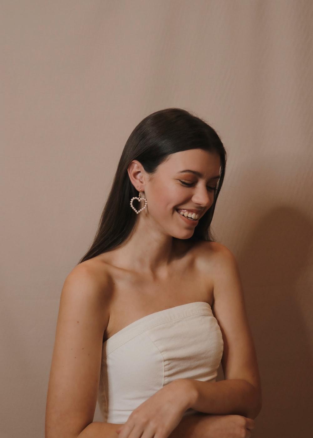 woman in white tube dress wearing silver hoop earrings