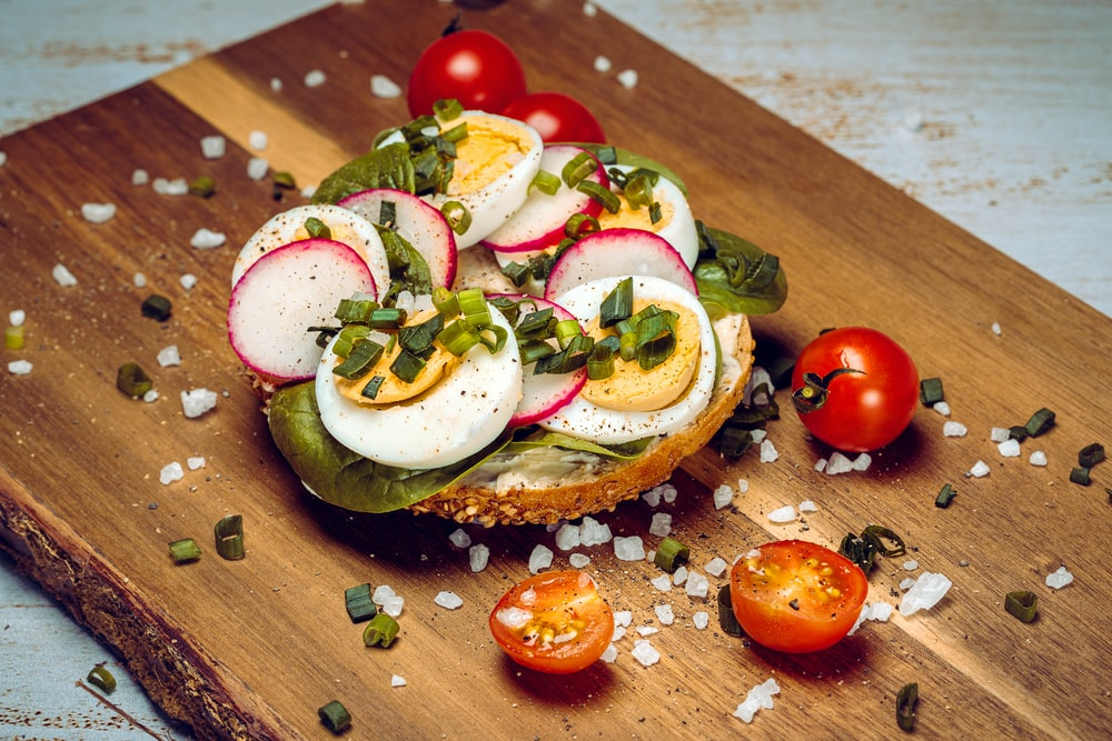 sliced tomato and cucumber on brown wooden chopping board