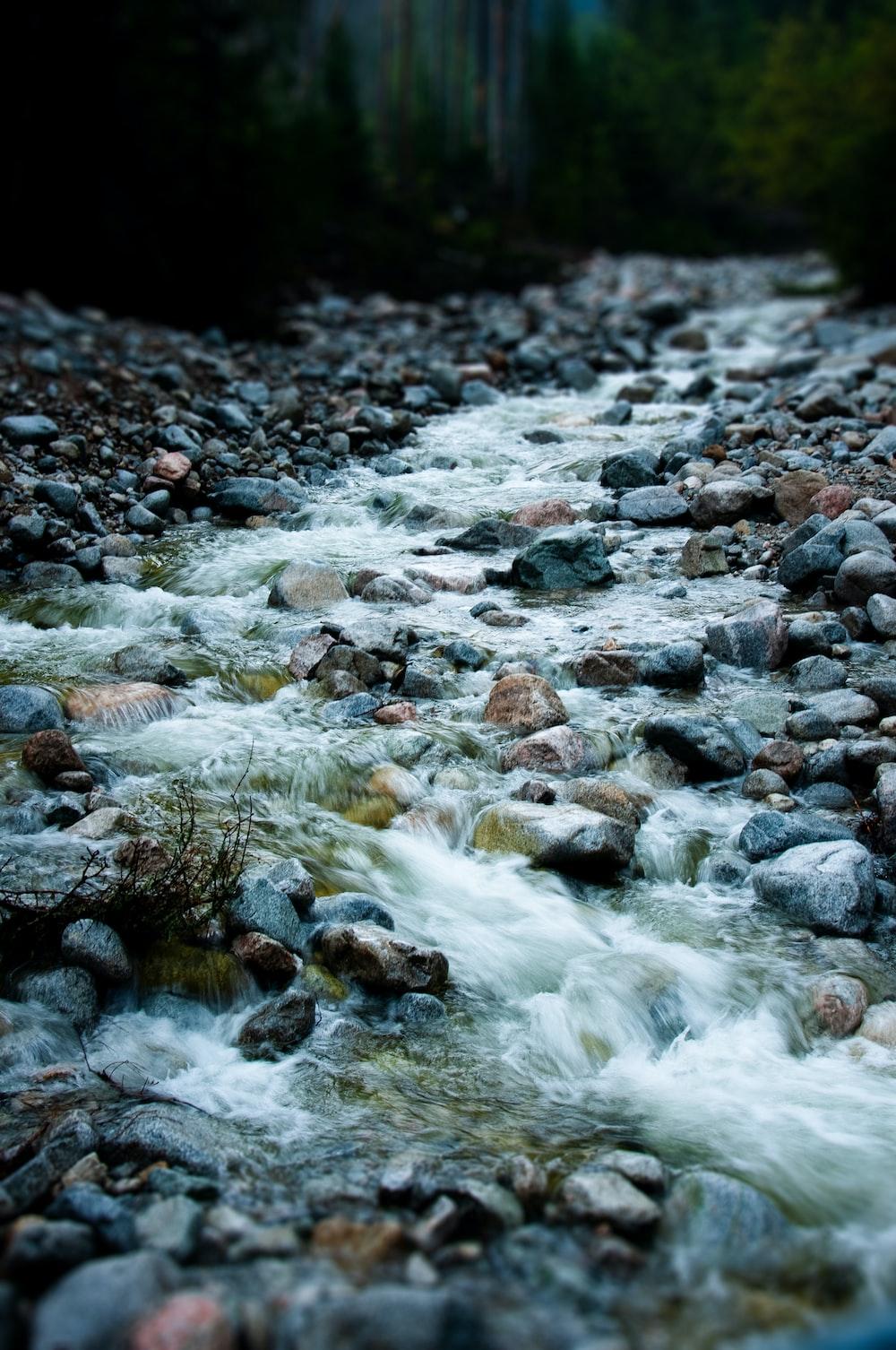 water flowing on rocky shore