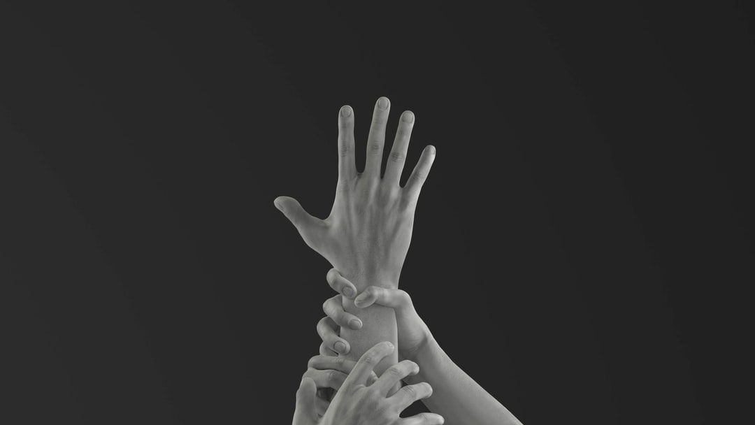 hands dragging and gripping, pulling a hand down - a cry for help