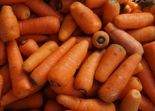 orange carrots on black surface