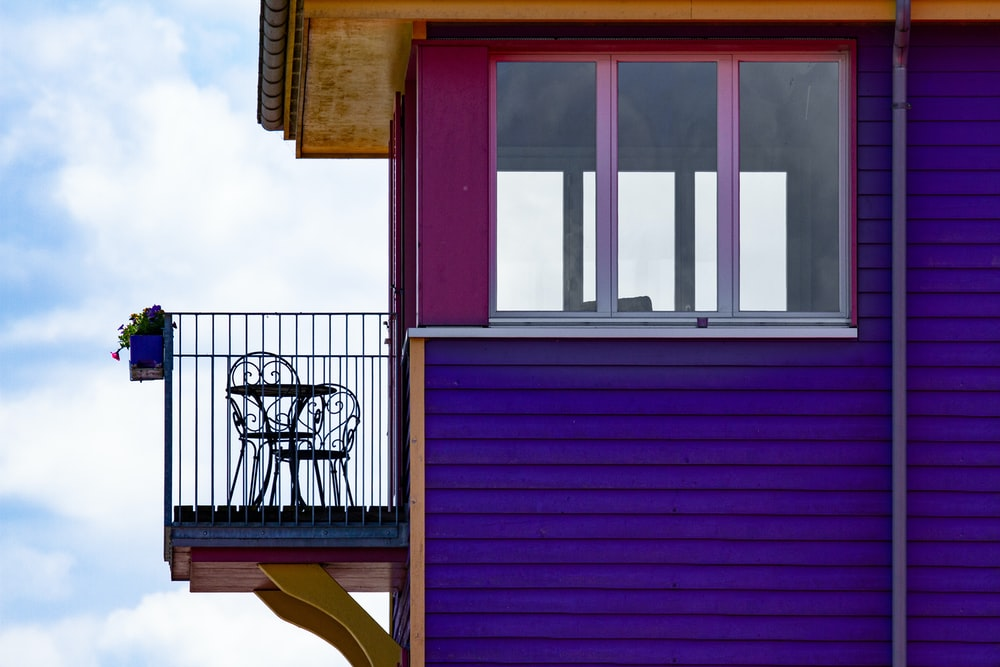 purple wooden house under white sky during daytime