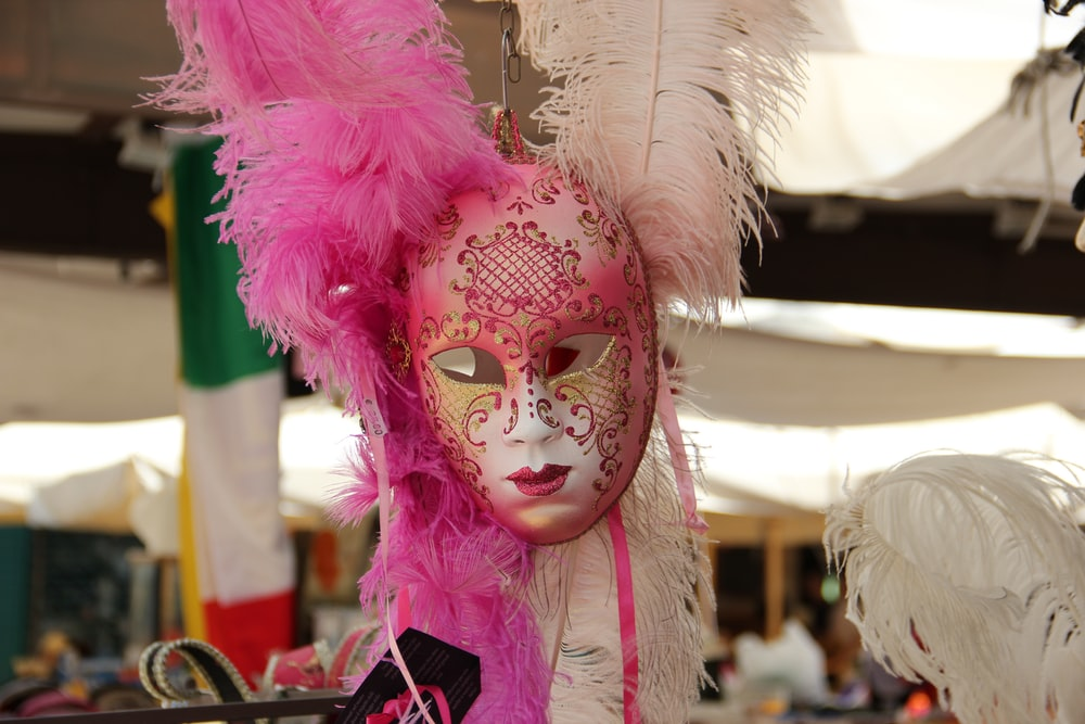 pink and white feather mask