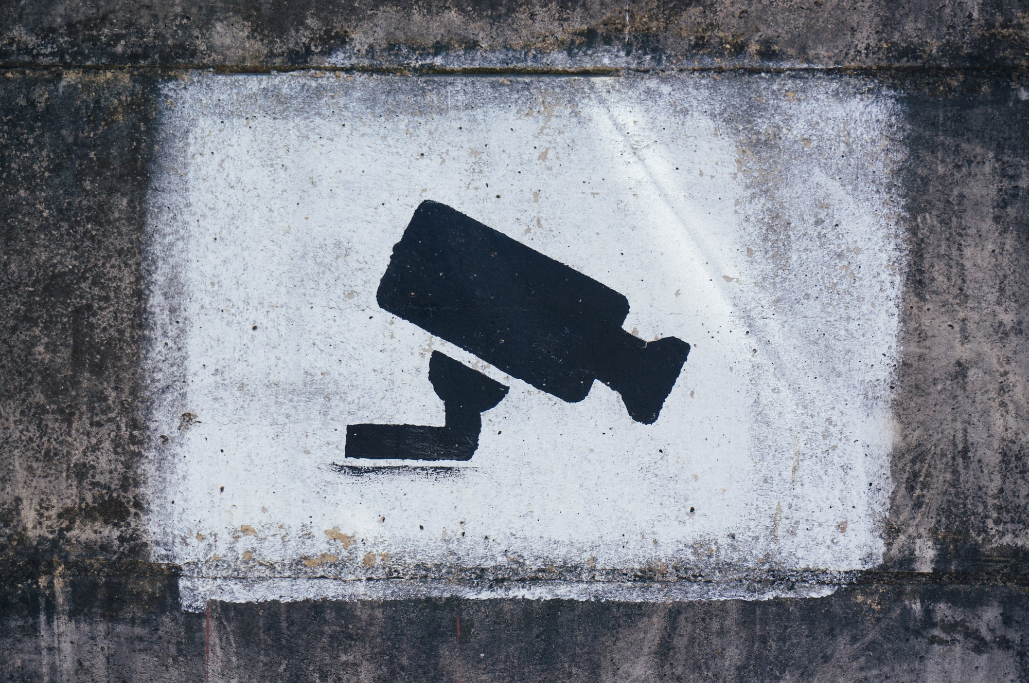 A painting on a wall warning visitors about video surveillance