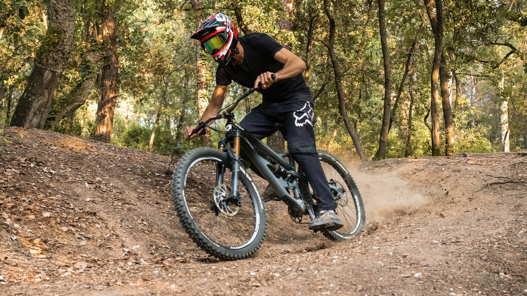 Dirt Bike Session in Girona, Catalunya, Spain. Free ride during a downhill in a golden forest.