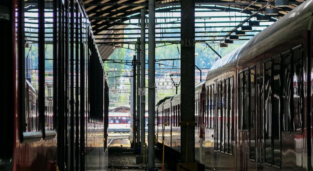 white train in train station during daytime