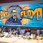 blue yellow and black graffiti on wall