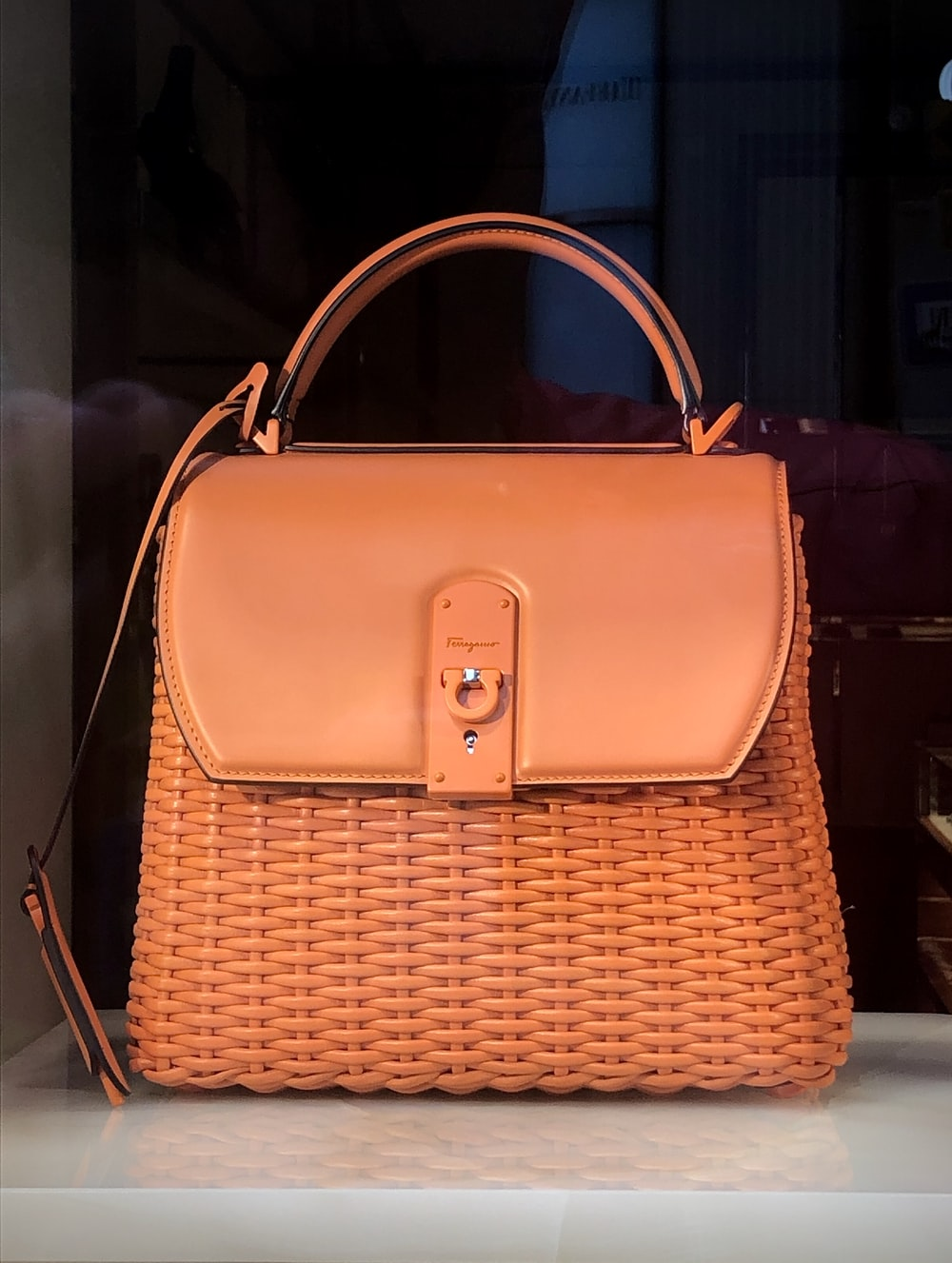 brown leather handbag on brown wooden table