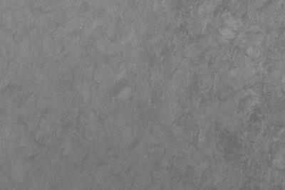 black textile on brown wooden table concrete teams background
