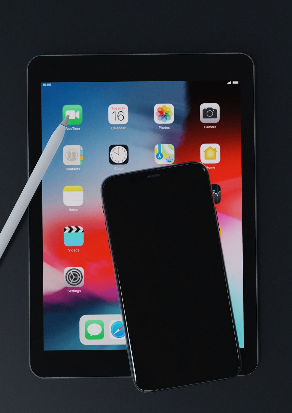 black iphone 5 on white ipad