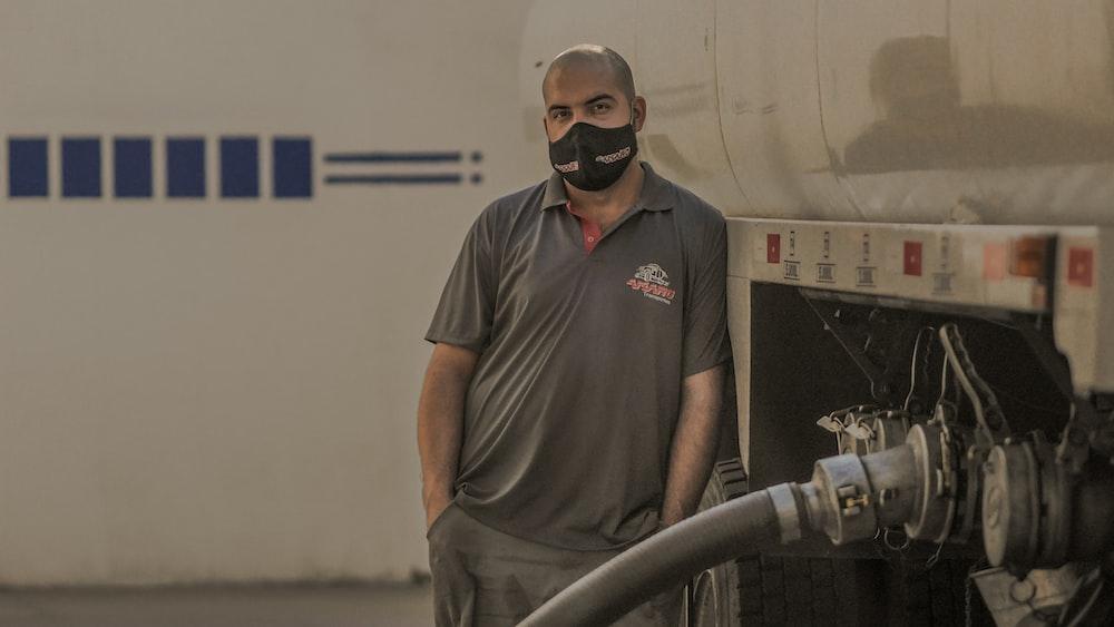 man in gray crew neck t-shirt wearing black sunglasses