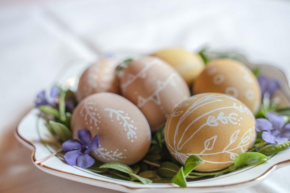 brown egg on white ceramic plate