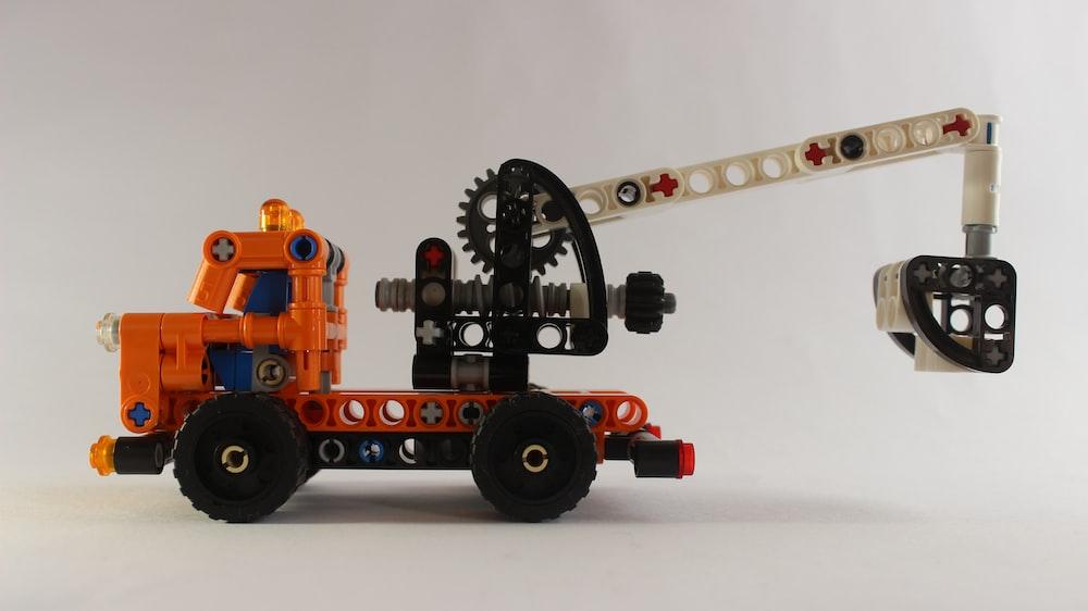 orange and black lego toy