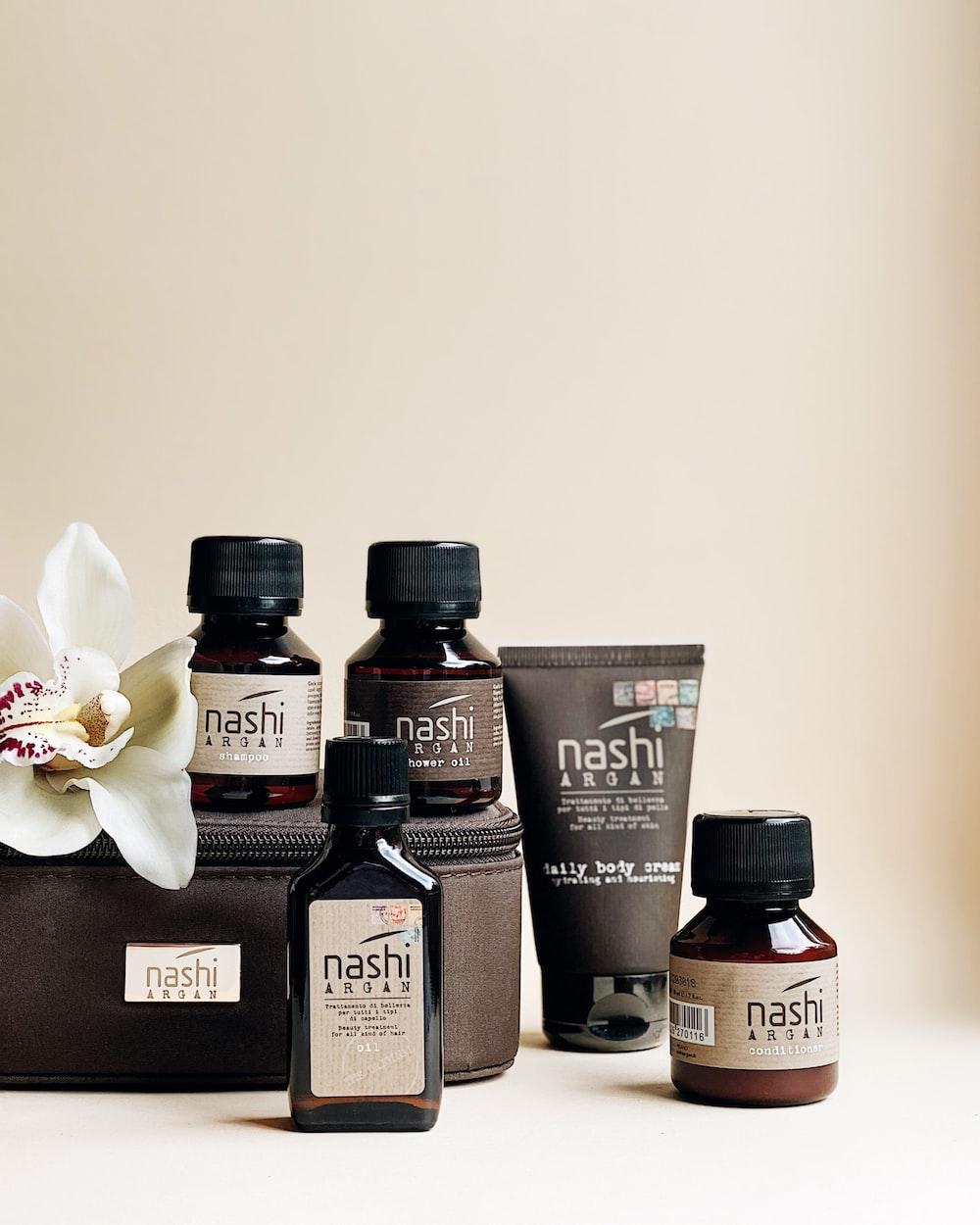 three black and brown bottles