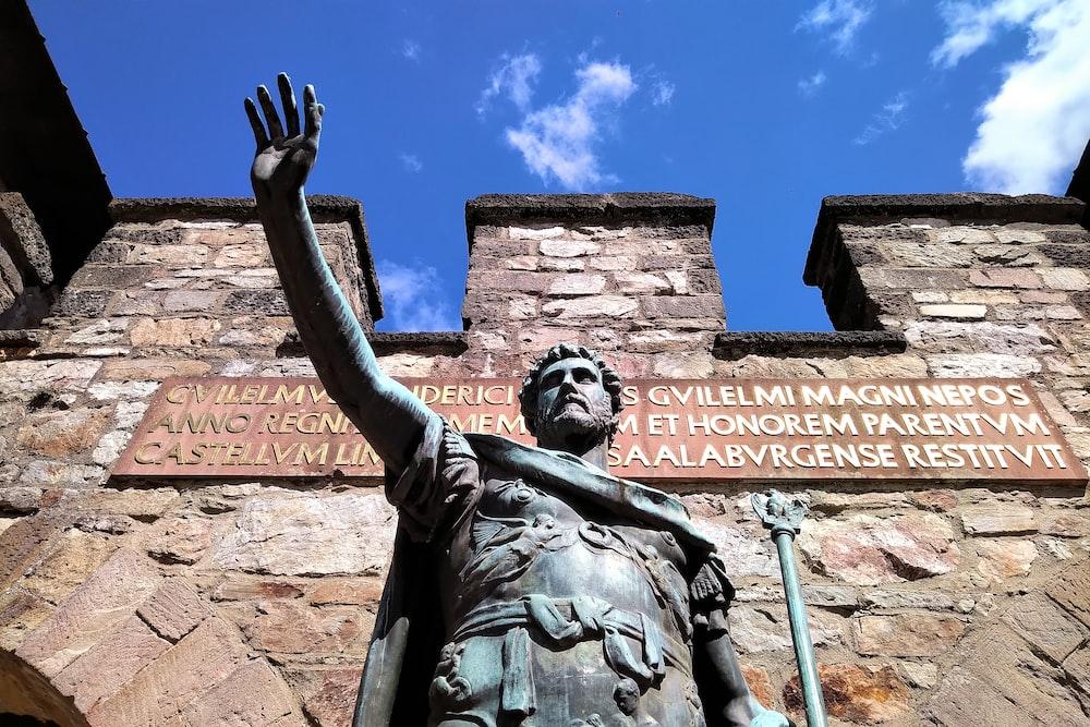 man raising his hand statue