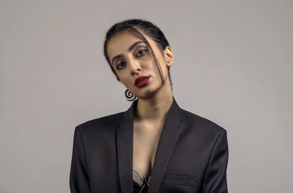 woman in black blazer with red lipstick