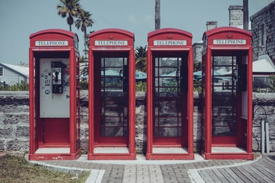 red telephone booth near green tree during daytime bermuda zoom background