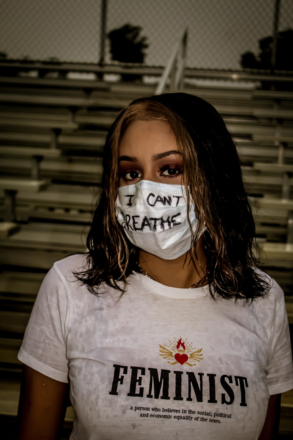woman in white crew neck t-shirt with white face mask