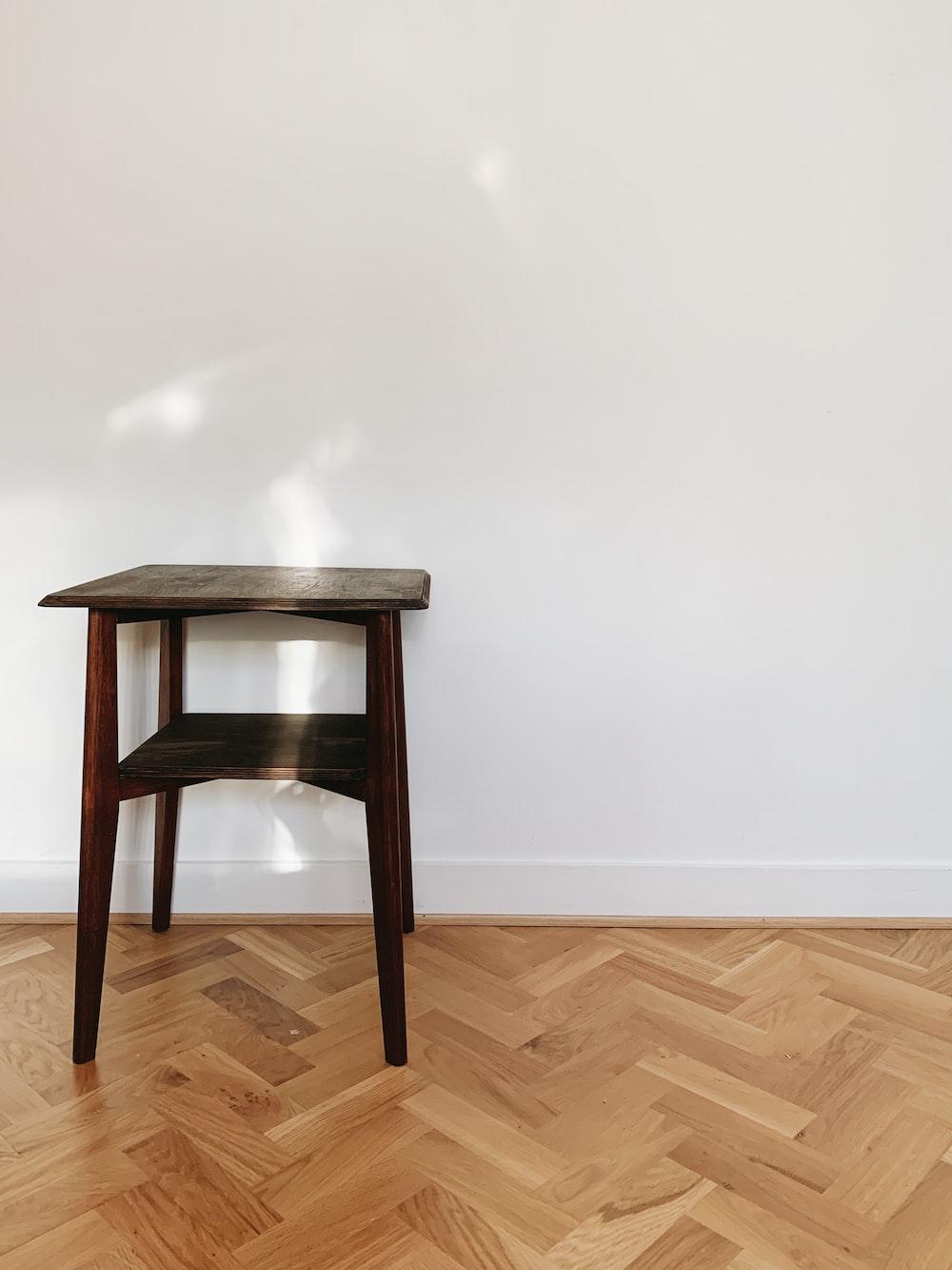 brown wooden seat on brown wooden parquet floor