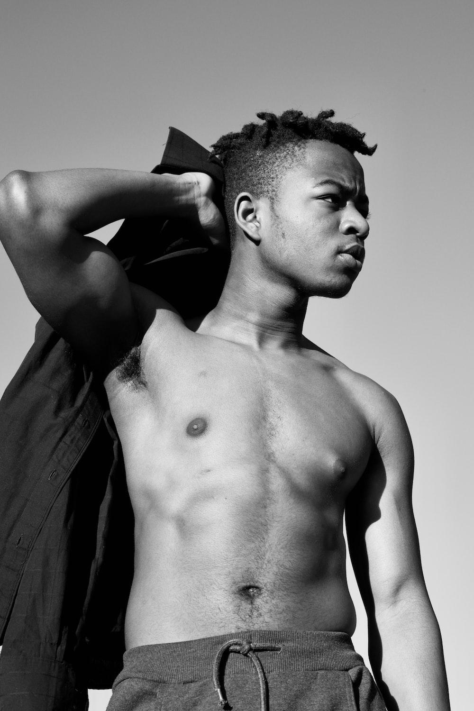 topless man with black necktie