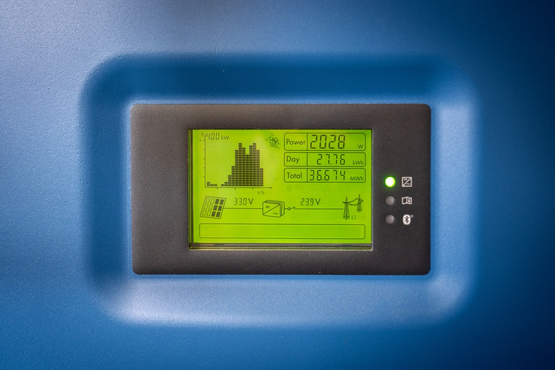The Display of A Sma Solar Rectifier, Used For Feeding the Power Grid With Solar Energy. You Can See: Current Output 2000 Watts, Today: 27 Kwh, Total: 36.7 Mwh, Voltage Solar Panels: 330 Volts, Grid Voltage: 240 Volts. - unsplash