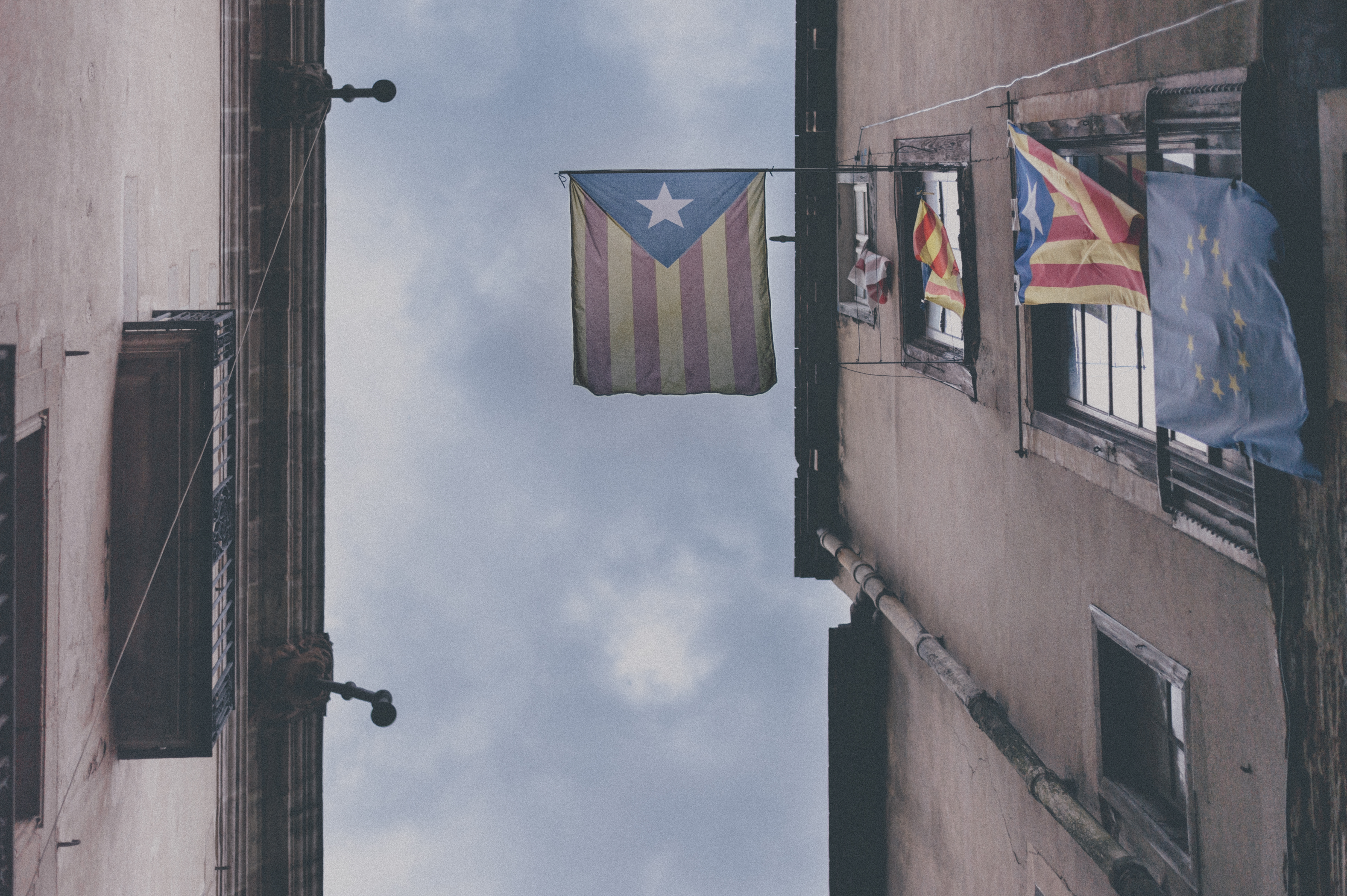 Flags of Catalonia and the European Union on the street of Barcelona.