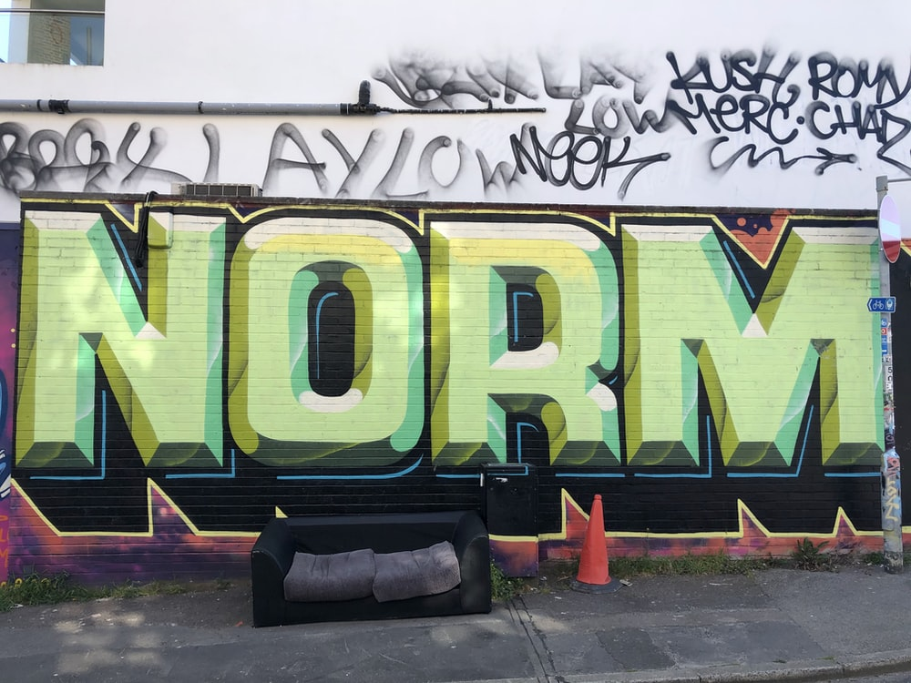 yellow and green graffiti on wall