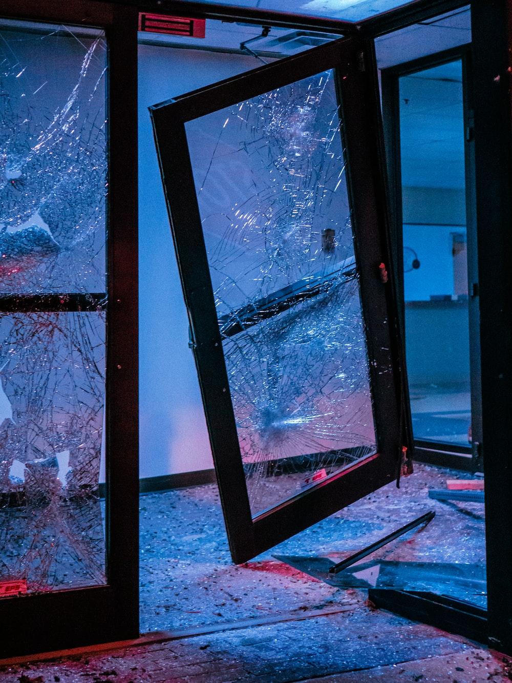 black framed glass window with white snow