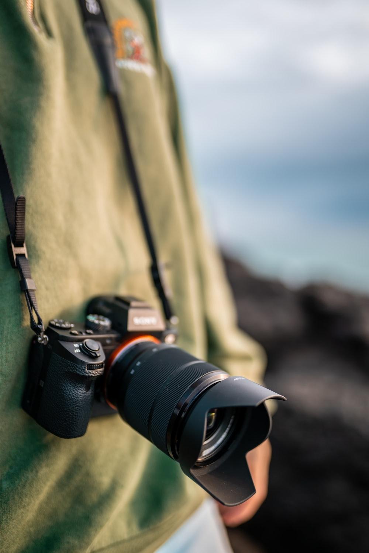 black nikon dslr camera on brown textile