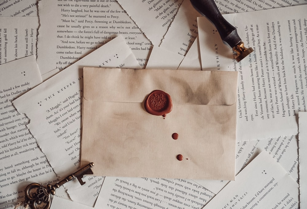 red button on brown envelope