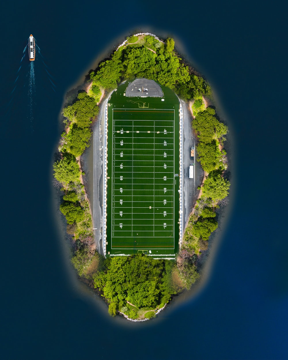 aerial view of green stadium on top of hill during daytime