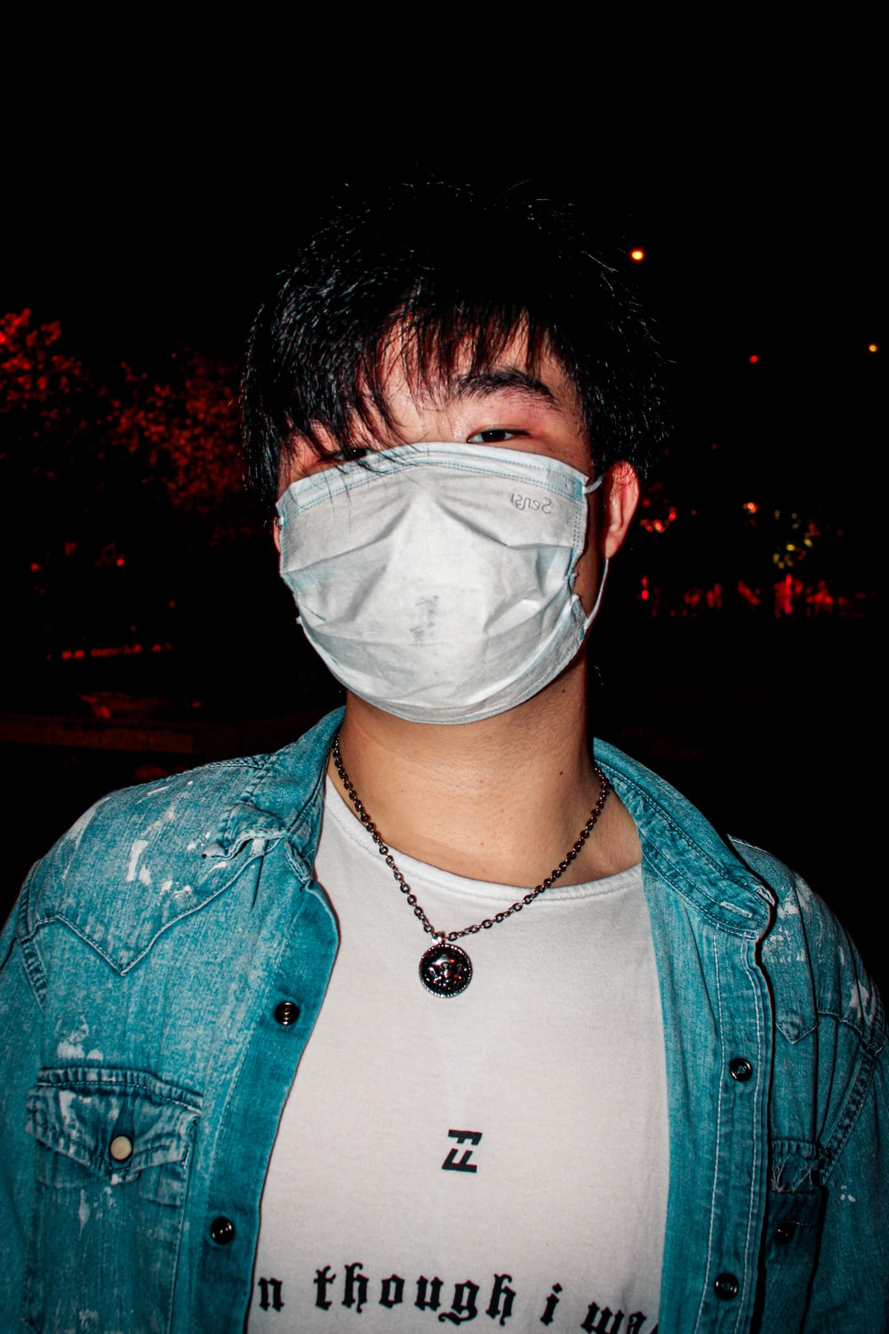 man in blue denim button up jacket with white face mask