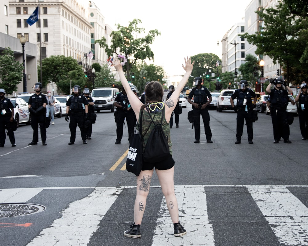 woman in green and black tank top raising her hands