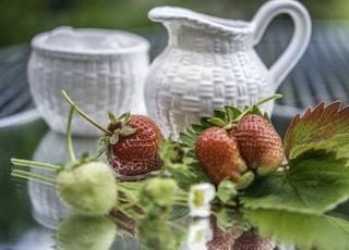 white ceramic pitcher with strawberries