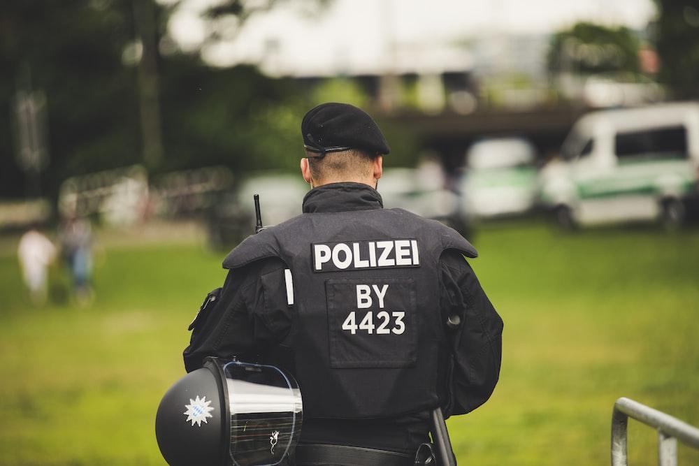 man in black and white adidas t-shirt wearing black cap