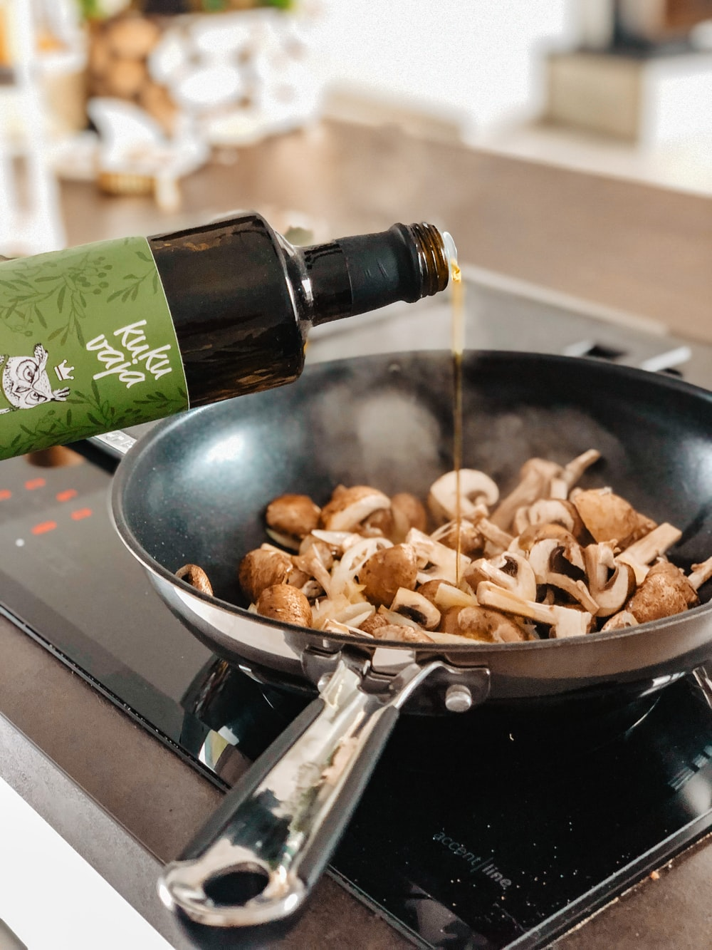 brown and black mushroom on black frying pan