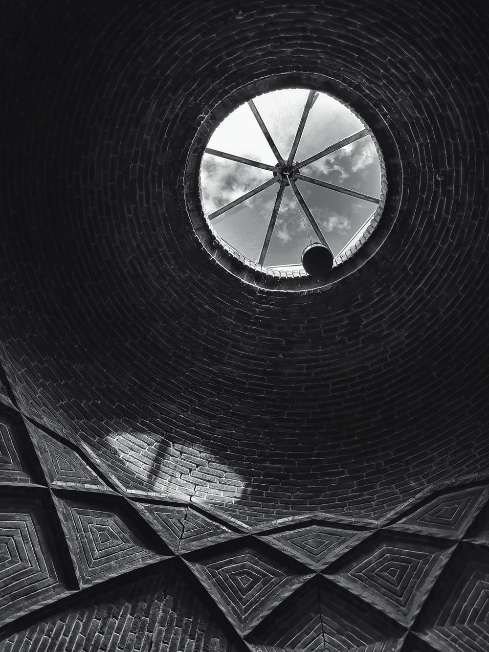 black and white tunnel with glass windows