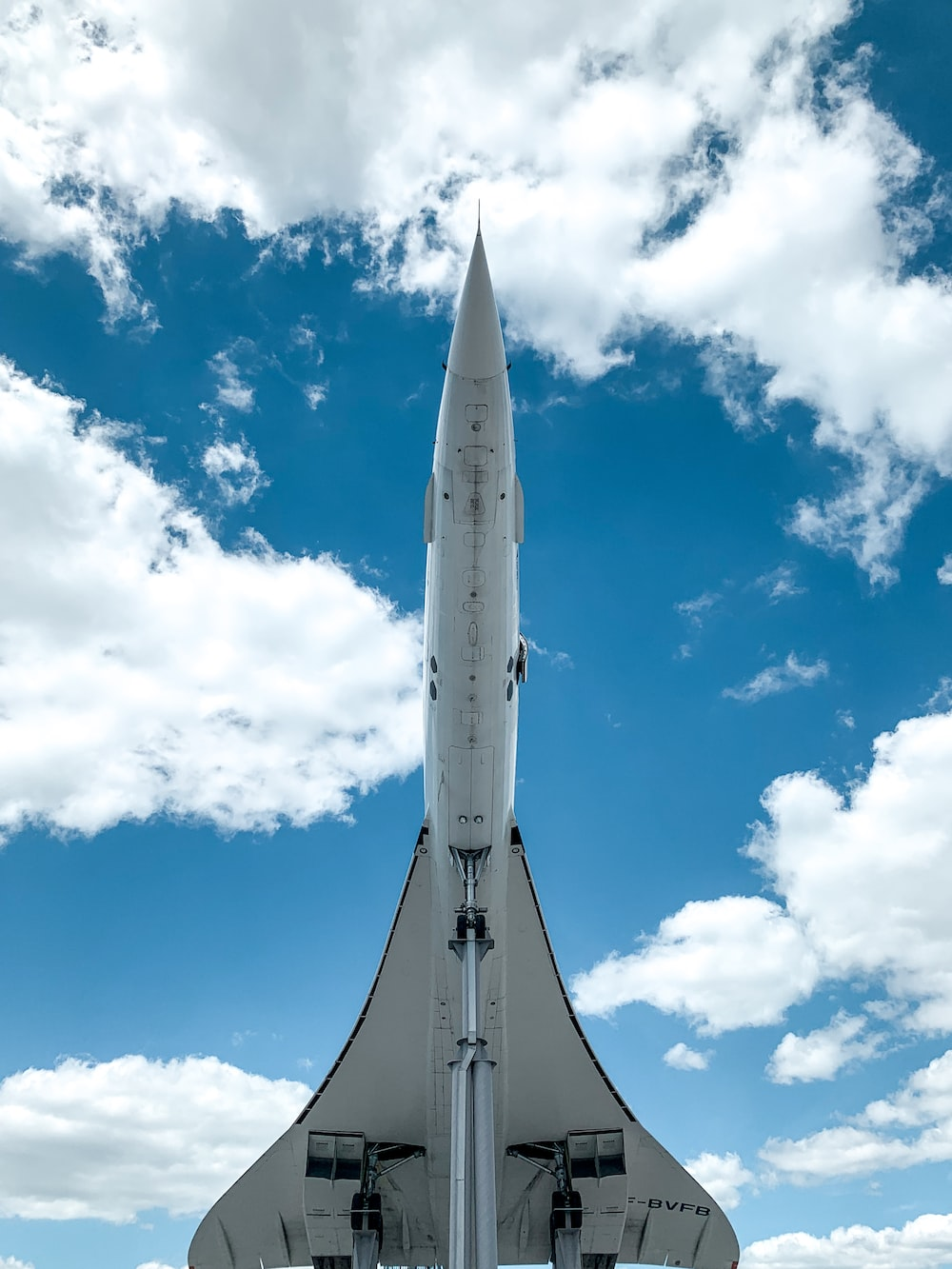 white and gray space ship under blue sky and white clouds during daytime