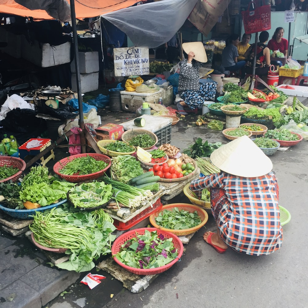 vegetable stand on market during daytime
