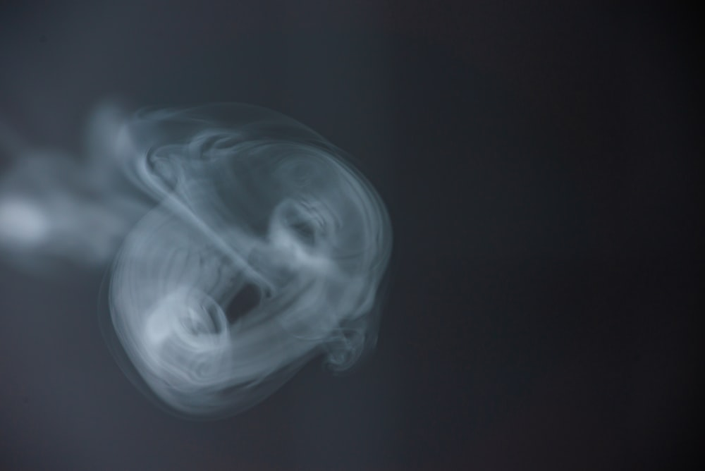 white smoke in black background