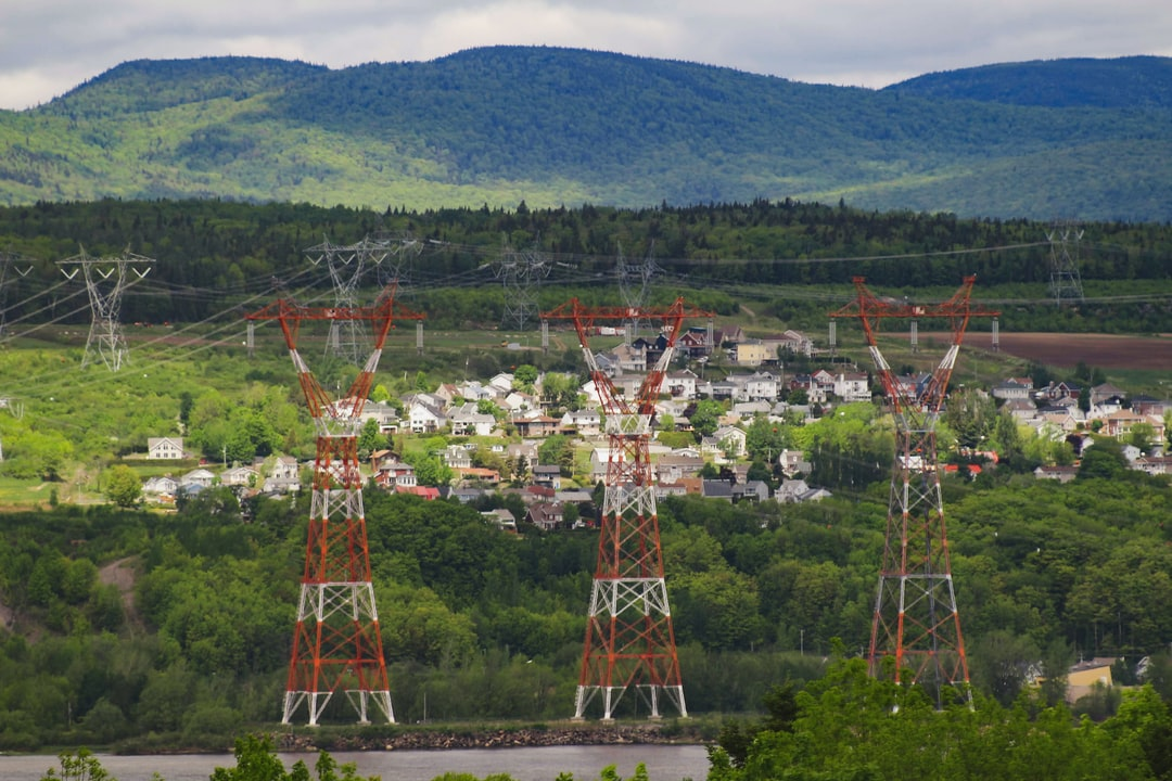 High voltage electrical grid pylons crossing the St. Lawrence River