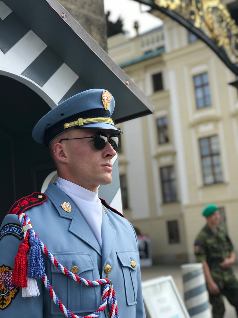 man in blue and red uniform wearing black sunglasses
