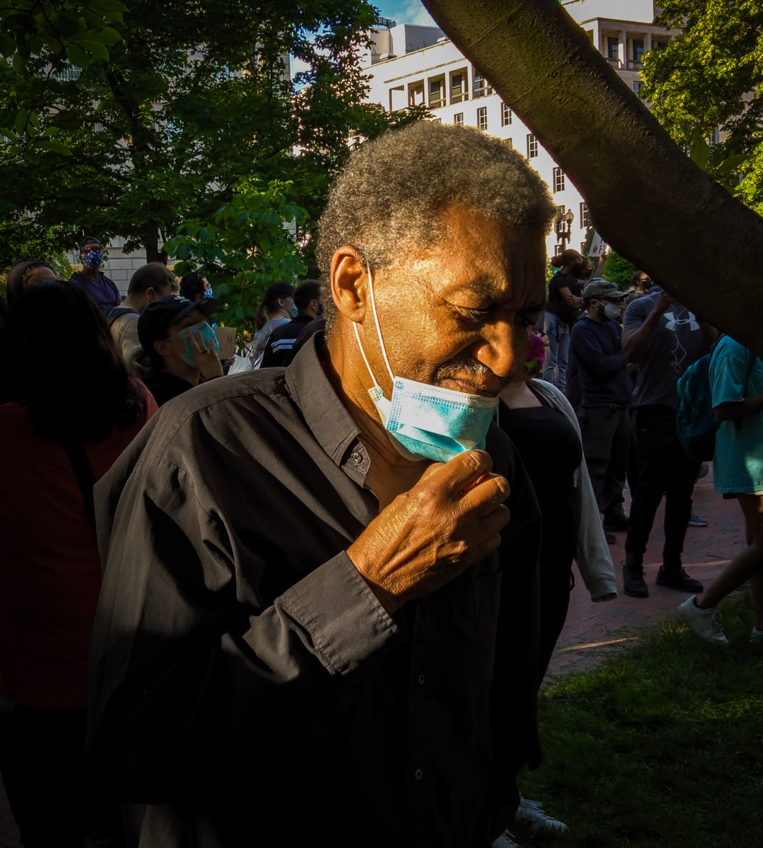 An African American Male protester is visibly upset while chanting near the White House in Washington DC.
