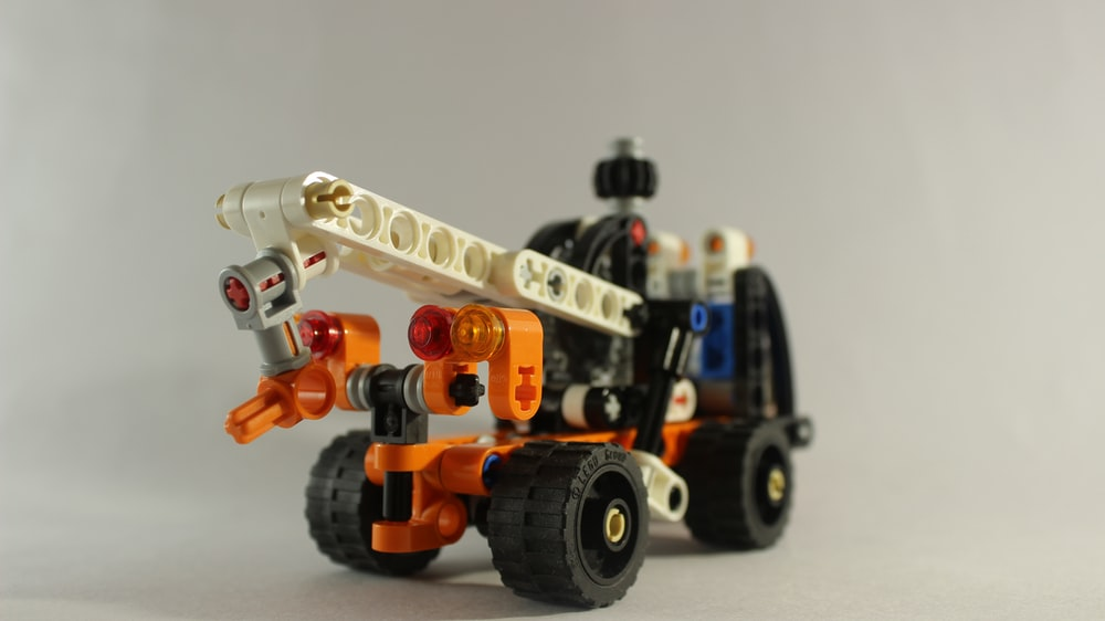 yellow and black lego toy